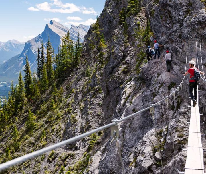 Cross a suspension bridge on the Mount Norquay Via Ferrata Explorer Route