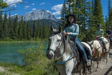 Take a guided horseback ride along the Bow River
